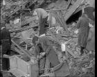 Looting the wreckages of shattered London homes