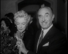 Jack Warner presents a Warner Bros. badge to Marilyn