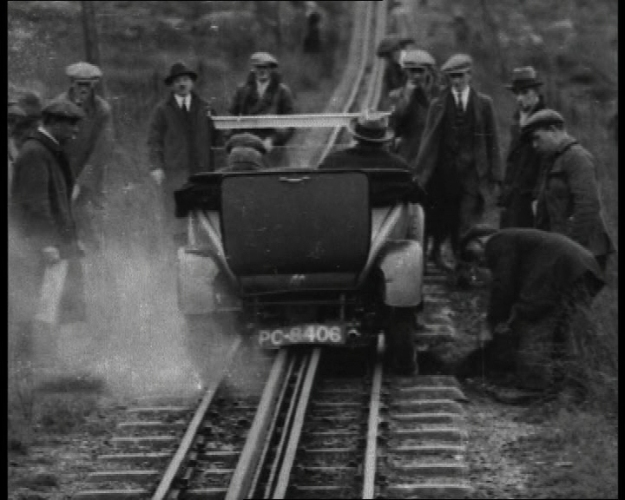 Four Reel Drive: Pathe recorded a group of men in the 1920s rescuing a vehicle.