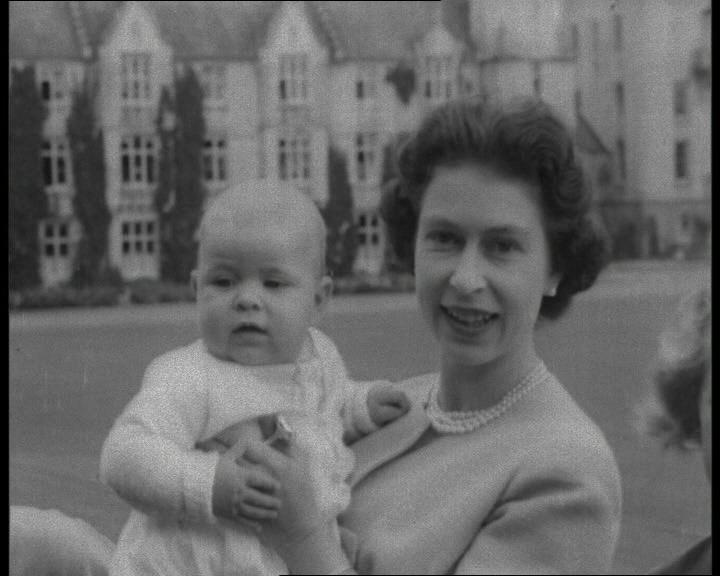 This still shows the Queen holding baby Prince Andrew. Click to visit our Royal Baby Names gallery.