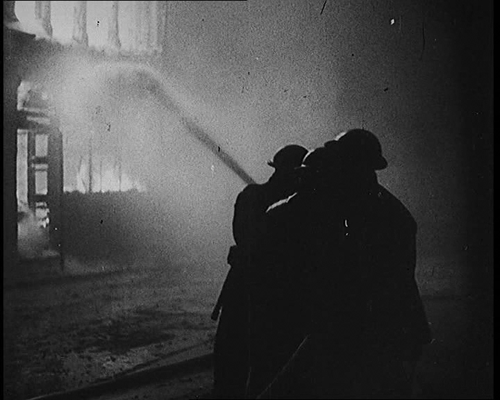 Firefighters battle flames during the Blitz, London (1941)