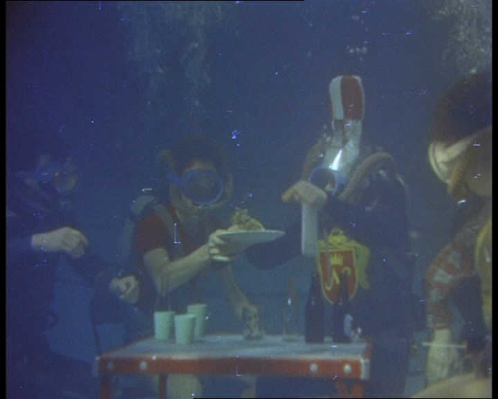 It's not all work and study though. There are many quirky clips of fun under the sea, including the underwater tea party seen in this still from the 1950s.