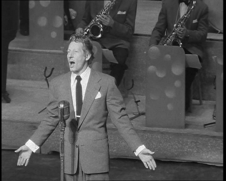 Danny Kaye rehearses for a performance.