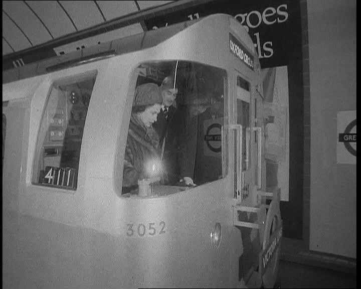 The Queen at the controls of the new automated tube trains that travel on the Victoria Line. Click the still to view the film.