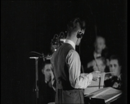 """Voice grafting - the latest miracle of sound science"" at HMV studios in 1932. Click the still to view the film."
