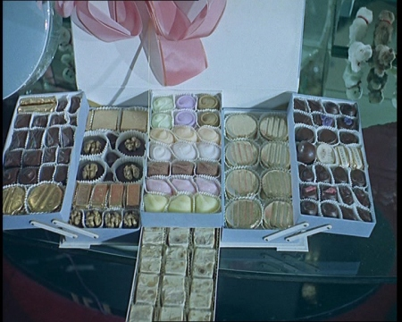 Scrumptious footage of chocolates being made.