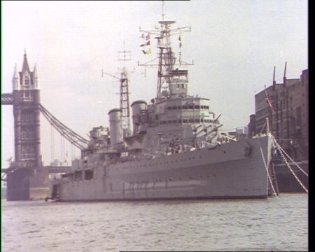 HMS Belfast on the Thames during the 1970s. View our collection of clips for the famous ship by clicking on the still.